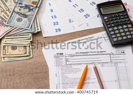 Form 1120 Corporate Tax Return with Calendar, Calculator and Pen