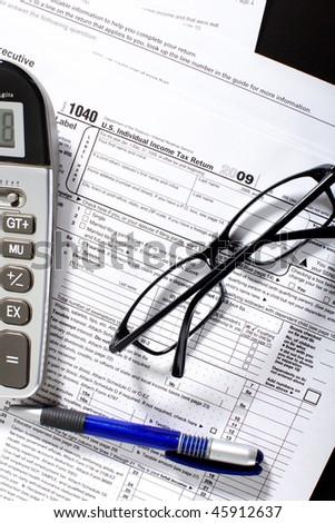 Form 1040. Standard US Income Tax Return. Calculator. Eyeglasses - stock photo