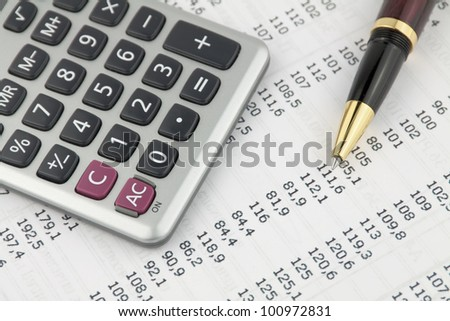 Form with pen and calculator - stock photo
