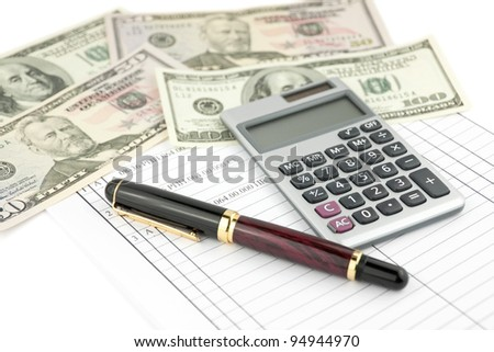 Form with pen, calculator and money