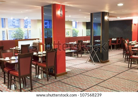 Formal breakfast table setup at hotel restaurant - stock photo