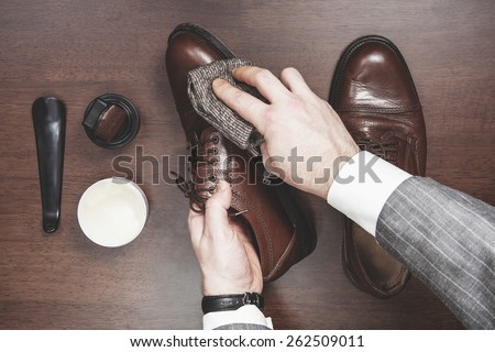 Formal business men leather shoes shining - stock photo