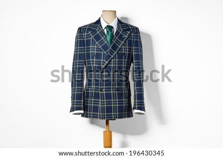 Formal checked suit on shop mannequins  - stock photo