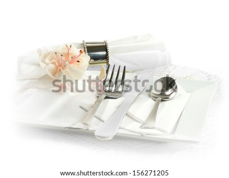 Formal dinner service as at a wedding or banquet. Stylish tableware against a white background with white and pink single fuchsia. Copy space. - stock photo