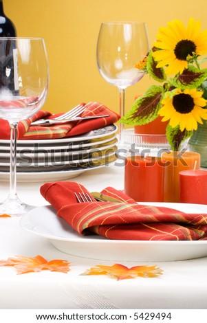 Formal fall festive theme dinner table arrangement - stock photo