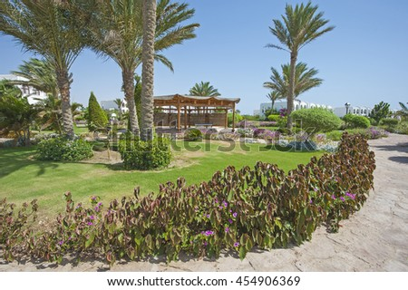 Formal landscaped gardens in grounds of a luxury tropical hotel resort with gazebo