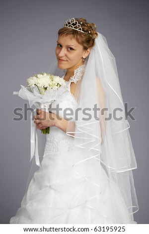 Formal portrait of beautiful bride on a gray background - stock photo
