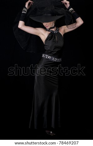 Formal Wear Striptease #1: High fashion model in cocktail gown removing her veil. - stock photo