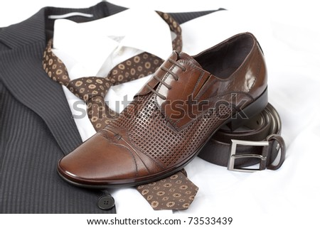 Formal wear with belt and brown shoes - stock photo