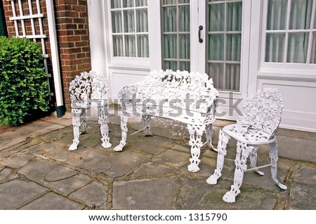 Formal wrought iron patio furniture. - Formal Wrought Iron Patio Furniture Stock Photo 1315790 - Shutterstock