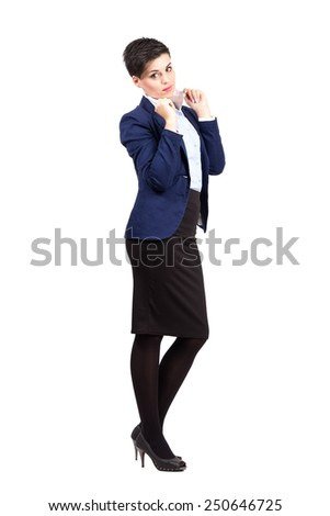 Formal young business woman posing while holding collar.  Full body length portrait isolated over white background. - stock photo