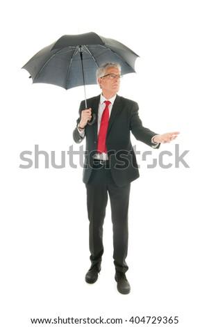 Formally dressed Senior business man with umbrella - stock photo