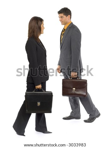 Formalwear man and woman are walking. They're passing by themselves and looking to each other face.