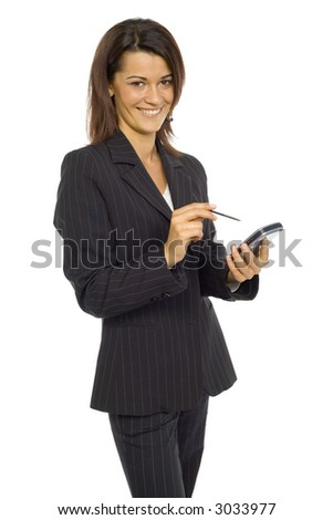 Formalwear woman standing and smiling at camera. She's holding pocket pc and pen. Isolated on white in studio.