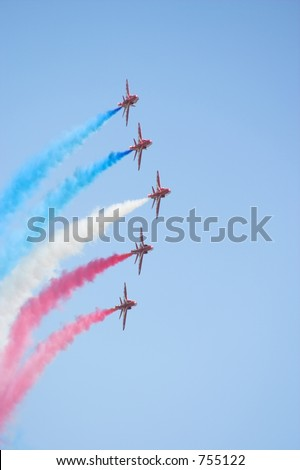 Formation flight of the Royal Air Force Aerobatics team the Red Arrows - stock photo