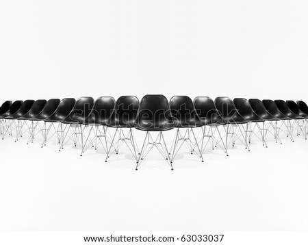 Formation of black chairs isolated on white background