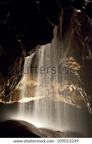 Formations and underground waterfall in Tuckaleechee Caverns in Townsend Tennessee, an abstract study of light and dark - stock photo