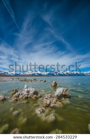 Formations emerge from the clear waters of Mono Lake in the Sierra Nevadas. - stock photo