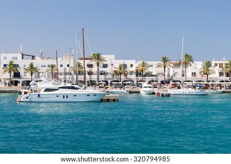 FORMENTERA, SPAIN - JUNE 30: Summer in La Savina harbour on Formentera island, Spain on June 30, 2007. - stock photo