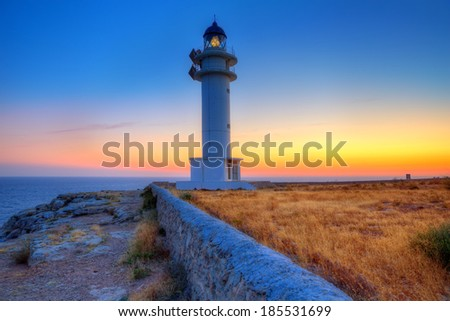 Formentera sunset in Barbaria cape lighthouse at Balearic Mediterranean islands - stock photo
