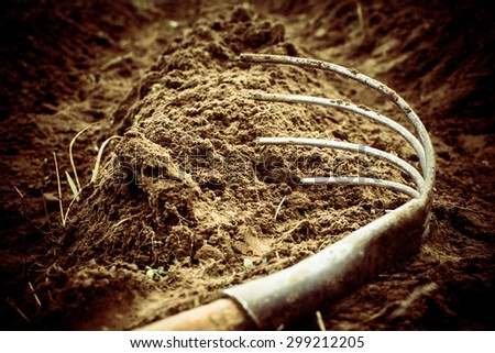 Former African-hoe digger lies on fertile land plowed treated.  - stock photo