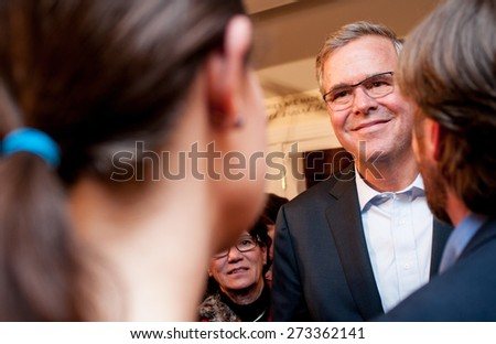 Former Florida Governor Jeb Bush speaks with voters in Dover, New Hampshire, on March 17, 2015.  - stock photo