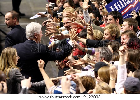 Former US President Bill Clinton with daughter Chelsea greeting fans in Denver while campaigning for Hillary Clinton
