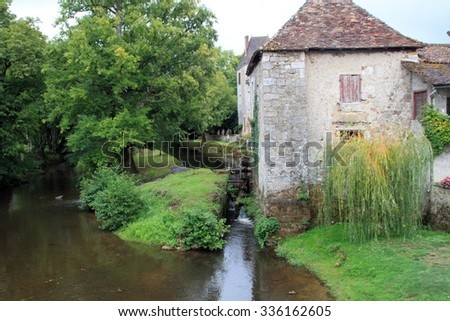 Former water mill in French village.