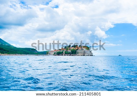 Formerly an island, Sveti Stefan is now connected to the mainland by a narrow isthmus, Montenegro. - stock photo