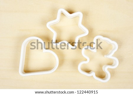 Forms for cookies on plywood background