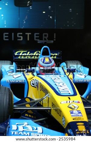Formula 1 car being displayed in a motor show.Editorial use.