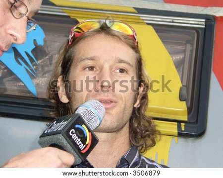 Formula 1-driver Jarno Trulli (ITA) being interviewed at a wine show in Seewen, Switzerland. Date: 16.09.2005