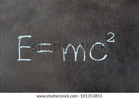 Formula e=mc2. Theory of relativity written on school chalkboard - stock photo