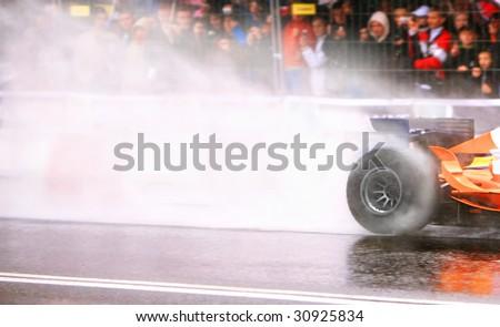 Formula One Car Wheelspin - stock photo