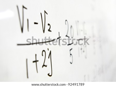 formulas on a whiteboard - stock photo