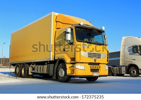 FORSSA, FINLAND - JANUARY 18, 2014: Renault Premium 410 delivery truck in arctic conditions. Renault Trucks aim to manufacture their vehicles reusing a maximum amount of its component materials. - stock photo