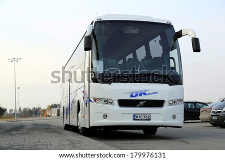 FORSSA, FINLAND - MARCH 1, 2014:  New Volvo coach bus waits for passengers. According to Volvobuses.com, weak global bus market shows sign of recovery in the fourth quarter of 2013. - stock photo