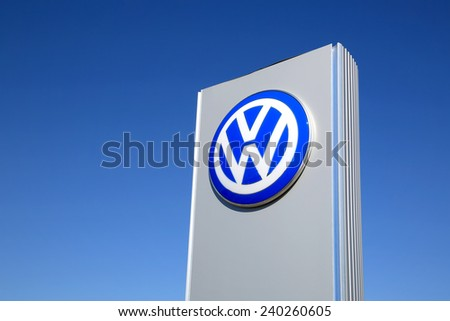 FORSSA, FINLAND - MAY 17, 2014: Sign Volkswagen against clear blue sky. The Volkswagen Group delivered over 9 million vehicles in period from January to November for the first time ever in 2014. - stock photo