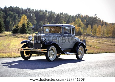 FORSSA, FINLAND - OCTOBER 3, 2015: Ford 2D Standard Coupe A/2640 on the road in Forssa. The nostalgic Model A is of year 1930.  - stock photo