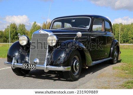 FORSSA, FINLAND - SEPTEMBER 6, 2014: Black Mercedes-Benz 170S parked on a yard. The Mercedes-Benz 170S was a luxury four cylinder passenger car manufactured between 1949-1952. - stock photo