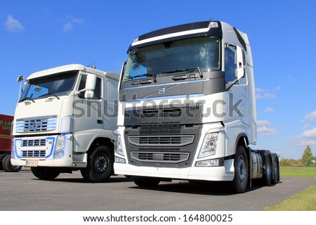 FORSSA, FINLAND - SEPTEMBER 14: Two Volvo FH trucks on September 14, 2013 in Forssa, Finland. In September 10896 Volvo trucks were delivered, an increase of 26% compared with the same month last year.