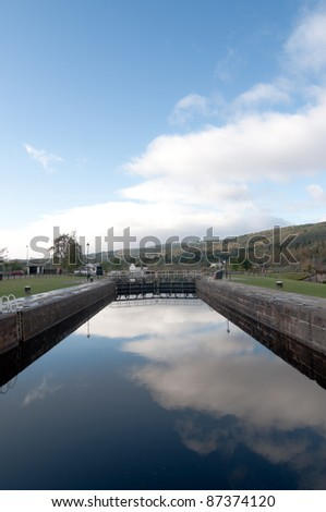 Fort Augustus Locks with reflection of the sky - stock photo