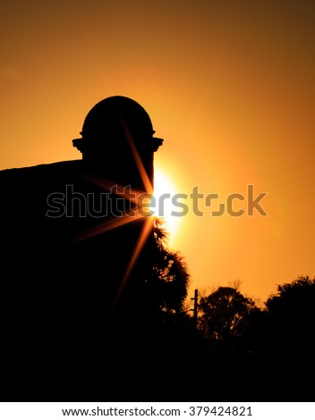 Fort Castillo de San Marcos in silhouette at sunset - stock photo