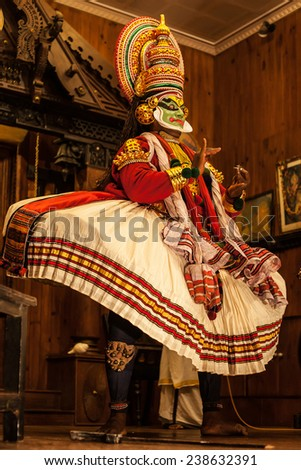 FORT COCHIN -  DECEMBER 7: Kathakali performer in the virtuous pachcha (green) role in Cochin on December 7, 2012 in South India. Kathakali is the ancient classical dance form of Kerala.  - stock photo