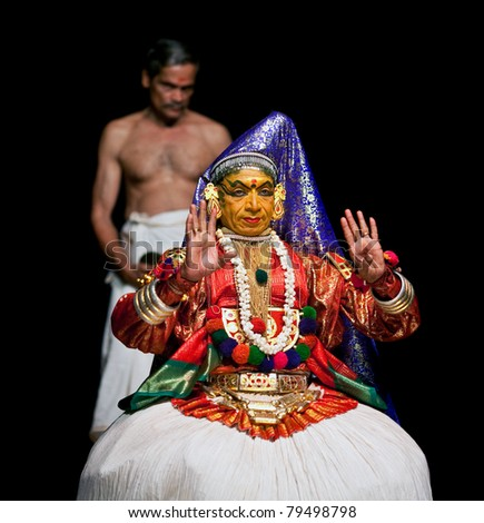 FORT COCHIN - FEBRUARY 17: Kathakali performer in the Lalitha role in Cochin on February 16, 2010 in Fort Cochin, South India. Kathakali is the ancient classical dance form of Kerala