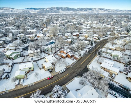FORT COLLINS, CO, USA - DECEMBER 13, 2015: Aerial  view of typical residential neighborhood along Front Range of Rocky Mountains in Colorado, late fall or winter scenery with snow. - stock photo