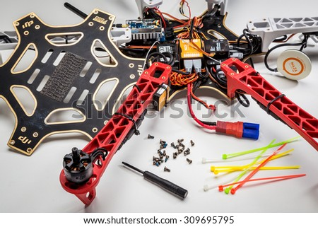 FORT COLLINS, CO, USA, JULY 20,  2015:  Repairing and rebuilding a drone after a crash - a partially disassembled DJI F550 Flame Wheel hexacopter with a  screwdriver and screws in front. - stock photo