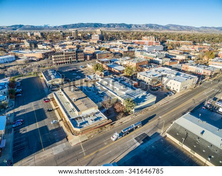 FORT COLLINS, CO, USA - NOVEMBER 15, 2015: Aerial view of Fort Collins downtown,  fall  scenery with Front Range of Rocky Mountains in background - stock photo