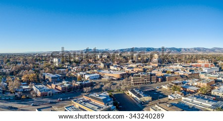 Fort Collins downtown aerial panorama,  fall  scenery od Colorado with Front Range of Rocky Mountains in background - stock photo