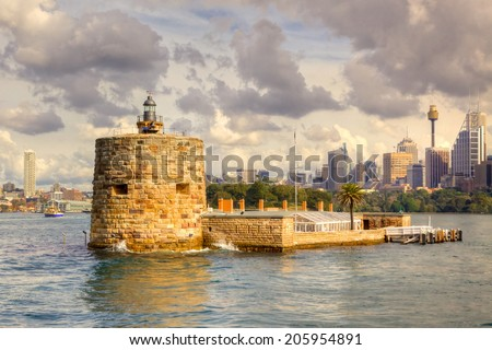 Fort Denison is a former penal site and defensive facility occupying a small island located about one kilometre east of the Opera House in Sydney Harbour, New South Wales, Australia.  - stock photo
